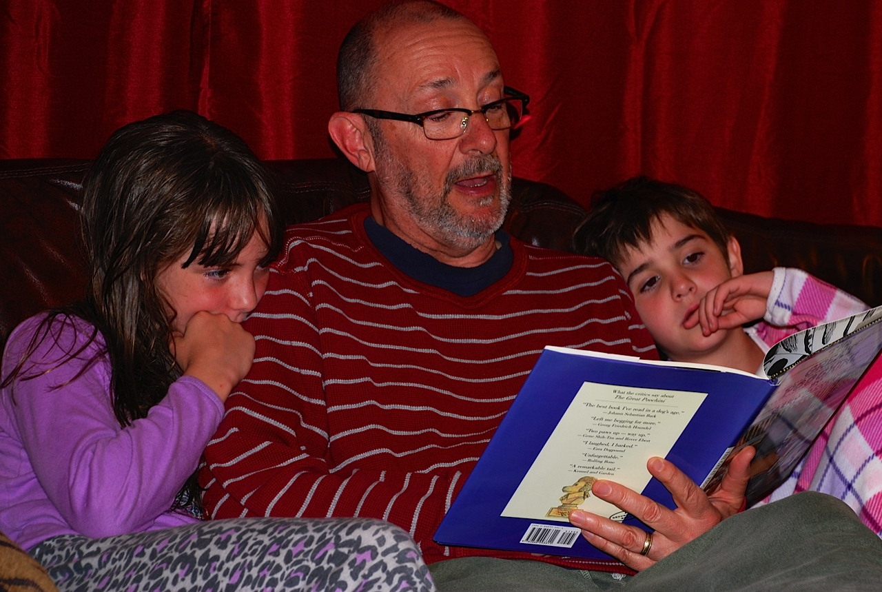 Marketing Manager Fred Horler, reading with his girls.